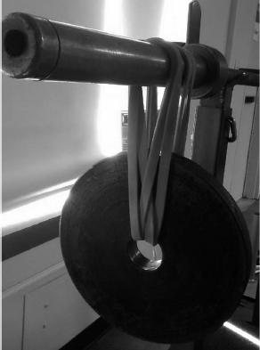 Skivstång med vikter i gummiband